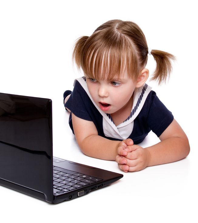 10675431 - the surprised little girl looks in a laptop