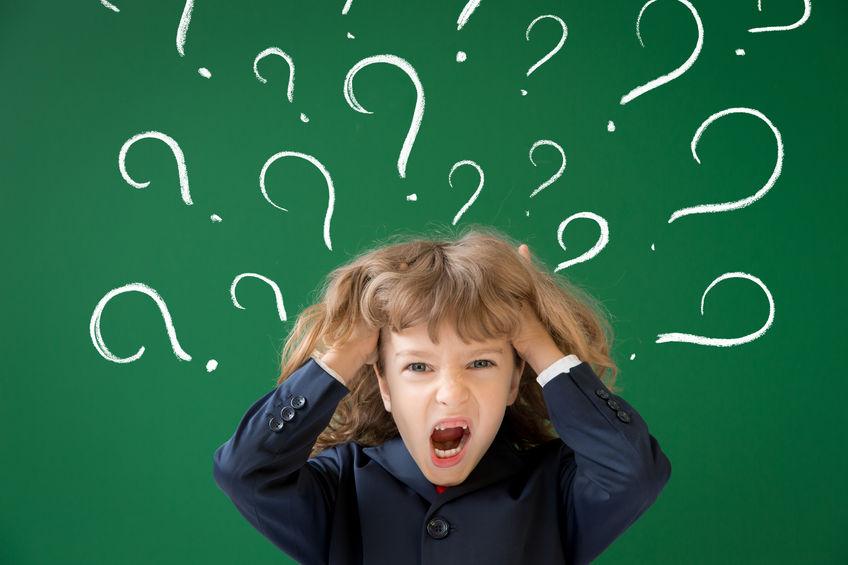 43604544 - school kid in class. happy child against green blackboard. education concept